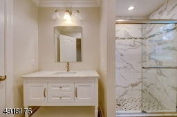 Tiled floor, beautiful stall shower features decorative tile and corner niches.  Linen closet.