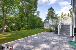 With the Deck easily accessed from the Dining Area and a Patio just off the Family Room - it creates a terrific flow for entertaining!