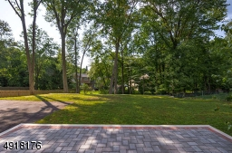 Enjoy a large, deep property - tree-lined and recently terraced.  Plenty of room for play - New landscaping has been added since this photo - must see and appreciate!