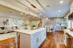 Truly a chef's delight! Beautiful wood cabinetry and center island with quartz countertops, marble backsplash.