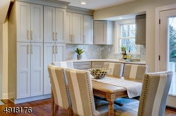 Custom designed and true delight! Ample built-in floor to ceiling cabinetry. Good counter space. Zepher 2-zone wine cooler & wet bar. Allows morning to night experience! Great as breakfast nook or for evening entertaining!