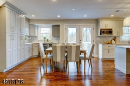 Spacious dining area is bright from the French doors which allow natural sunlight to flow in! It also allows access to the Deck and overlooks the large, deep backyard.