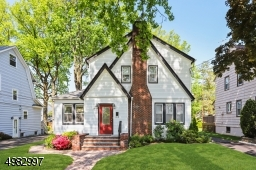 Beautiful curb appeal surrounds this Storybook Tudor