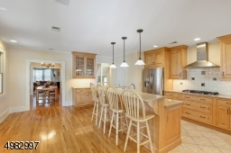 view of the kitchen opens to the Formal Dining Room and den