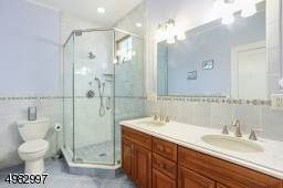 features two sinks, soaking tub, stall shower