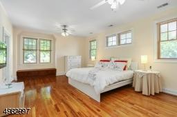 Large master bedroom boasts hardwood floors, high ceilings, walk- in closet