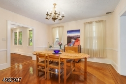 large formal dining room, wood floors with ribbon in-lay
