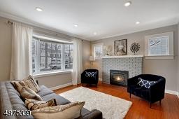 Gas Fireplace. Beautiful Hardwood Floors throughout