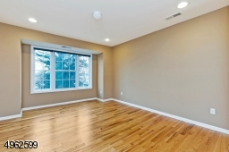 Spacious master with hardwood floors, a walk-in closet and full bath with double vanity