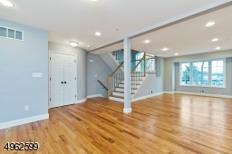 Spacious with plenty of sunlight and hardwood floors. This level includes a powder room, coat closet, dining room and eat-kitchen with breakfast bar and balcony