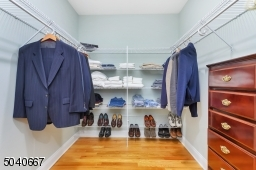 With custom fitted walk-in closet