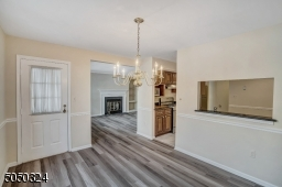 New floors flow throughout Dining Room  which is open to Family Room