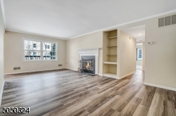 Family Room is so spacious and filled with light....enjoy the glow of the fireplace this winter!
