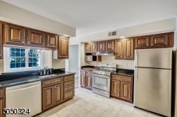 Rich wood cabinetry matched with stainless steel appliances make this the perfect kitchen for any cook!