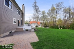 Paver patio, deck and beautifully landscaped yard.