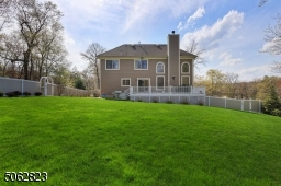 Paver patio, deck and beautifully landscaped, fenced yard.