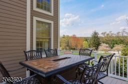 Maintenance-free deck overlooking the property.