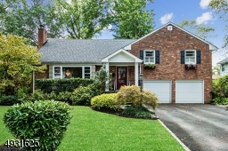 Portico, window boxes, paver walk ways & professional landscaping enhance the curb appeal of this charming Northside Cranford Home in the Brookside School District.