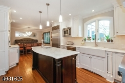 The white carrera marble top with prep sink will make cooking a breeze!