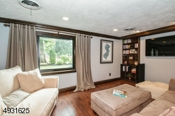 Grade Level Family Room boasts a picture window, built--in bookcases, an adjacent powder room and a door to the yard.