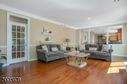 Sunny large family room with french doors to the first floor office.