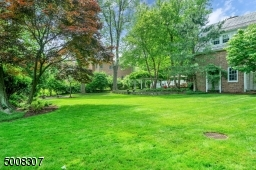 Large level lush property with 3 bluestone patios