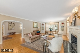 Entertain in style in this front to back sun drenched living room with fireplace & windows on either side