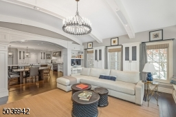 Enjoy the timeless elegance of this phenomenal family room with custom builtins, desks for home work & unique high ceiling