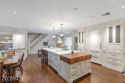Timeless Kitchen with custom wood cabinets with & desk, beautiful wood floors with radiant heat.