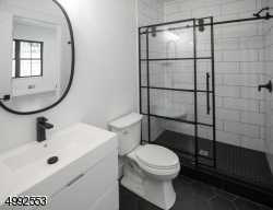 First floor full bathroom - attached to bedroom for possible inlaw suite.