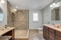 SPA-LIKE MASTER BATH WITH STALL SHOWER, FRAMELESS DOOR, HEATED FLOORS