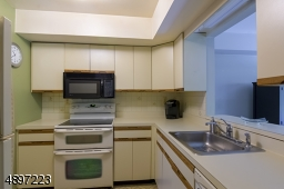 Kitchen with pass through into dining room .