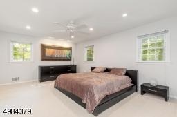 with en-suite full bathroom. HW under carpeting