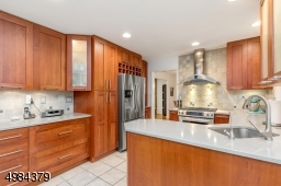 with solid cherry cabinets, SS appliances, Ceasarstone counter