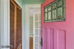 A beautiful stained glass window and large coat closet in the entryway welcomes guests.