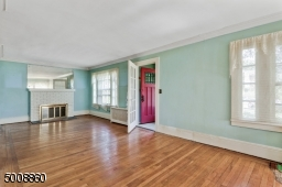 Gorgeous hard wood floors add ambiance to the spacious living room.