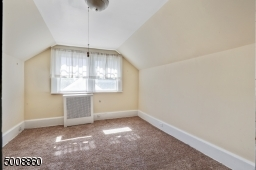 A sizable bedroom/home office with large windows make a great place to work or just relax.