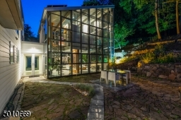 Contemporary Gem in Millburn with a 28 ft glass and steel addition and the South Mountain Reservation in your backyard!