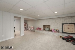Basement is set up to accommodate a playroom, another office Space ,full bath and a laundry /utility room.