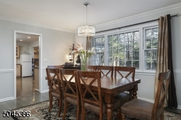 Gather with loved ones in this beautiful formal dining room / living room also features a warm inviting fireplace