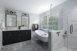 Featuring soaking tub and frameless shower