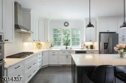Featuring top-of-the-line appliances and quartz countertops