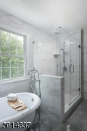 Featuring soaking tub and frameless shower door