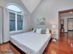 High ceiling guest bedroom
