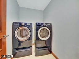 Laundry room conveniently located on the second floor.