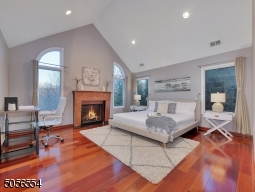Primary bedroom featured with cathedral ceiling, gas fireplace, walk in closet, oversized ensuite.