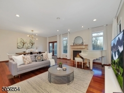 Family Room with large Andersen windows, gas fireplace, connected to private deck and backyard