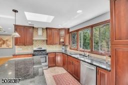 Stainless Appliances, Center Island, Large Windows & Skylight
