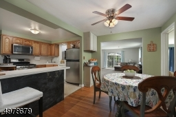 easy access  to family room, living room & four season porch.