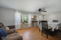 Hard wood floors, coat closet & ceiling fan.